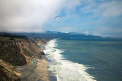 Coast paraglide Stock Photography