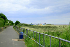 Coast Path. CHAPEL ST. LEONARDS, LINCOLNSHIRE, UK. AUGUST 04, 2015. The coast path and promenade leading to Chapel Point from Chapel St. Leonards in stock photo