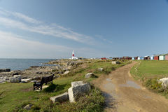 Coast path and lighthouse, Portland Bill Stock Photography