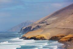 Coast in Peru. Deserted coastline landscapes in Pacific ocean, Peru, South America royalty free stock photo