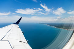 Coast through plane window Royalty Free Stock Photography