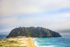 Coast at Point Sur Light Station in fog Royalty Free Stock Photo