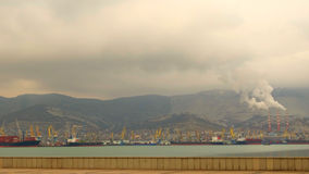Coast port city of Novorossiysk. Sea ecology industrial emissions waste Stock Images