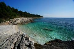 Coast in Premantura Pensinsula, Croatia. Beach with crystal-clear water in Premantura Peninsula rugged coastline, Croatia royalty free stock photos