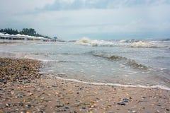 On the coast of the raging sea Stock Photo