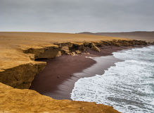 The coast and red sand beach of Paracas National Reserve Royalty Free Stock Image