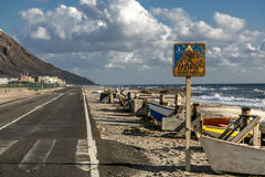 Coast road. Is a coastal road with fishing boats Royalty Free Stock Images