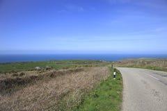 Coast Road and fields Cornwall England. Coastal Road and farm fields in South Cornwall England stock photos