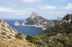 Coast road in Majorca - RAW format. Coast road in Majorca with cloudy sky and mountains Stock Photo