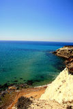 Coast rocks, beach & blue turquoise sea, Sicily Royalty Free Stock Photos