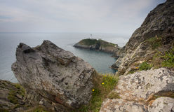 Coast rocks lighthouse Stock Photos