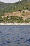 Coast route of Thassos island in Greece. Coast route of Thassos island in a beautiful day of summer stock photos