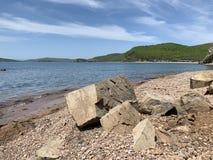Coast of the Russkiy Russian, Russky island opposite the island of Shkot. Vladivostok, Russia.  stock photos