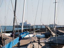 At the coast with sailing boats. In background view to the eastbourne pier in sussex stock image