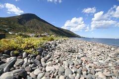 Coast of Salina, Italy. Flint pebbles stones, Island Salina, one of Lipari  Islands, south Italy Stock Photography