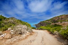 Coast of Sardinia, sea, sand and rocks Stock Images
