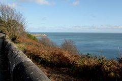 Coast of the Sea in Autumn in Dublin Ireland. Shore of the sea in the autumn near Dublin dark blue water in the distance mountains bordering the shore in the Royalty Free Stock Photos