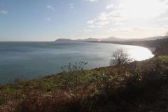 Border of the sea and sky. Autumn in Dublin Ireland. Coast of the sea in the autumn near Dublin dark blue water in the distance mountains bordering the shore in Royalty Free Stock Photos