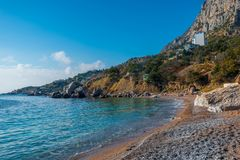 Coast of the sea bay, surrounded by mountains. Sunny seascape royalty free stock photos