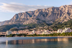 Coast sea and beach below mountain Biokovo in town of Makarska Royalty Free Stock Image
