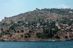 The coast of the sea. Beautiful cliffs over the blue . the wall of the fortress, the ancient city of Alanya, view from Royalty Free Stock Photos