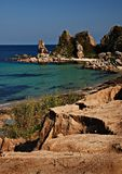 Coast of Sea of Japan. Sandy beach and rocks, Primorye, Russia, turquoise water, summer scene, beautiful landscape Stock Photography