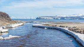 The coast of the Sea of Okhotsk in spring Royalty Free Stock Photo