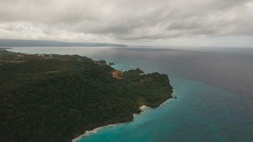 Coast sea in stormy weather.Aerial view:Boracay island Philippines. Rocky shore on the tropical sea with the rainy cloud. Aerial view:Stormy weather on island stock video footage