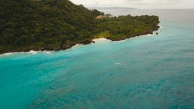 Coast sea in stormy weather. Aerial view: Boracay island Philippines. Rocky shore on the tropical sea with the rainy cloud. Aerial view:Stormy weather on island stock video footage