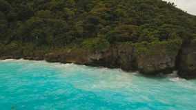 Coast sea in stormy weather. Aerial view: Boracay island Philippines. Rocky shore on the tropical sea with the rainy cloud. Aerial view:Stormy weather on island stock footage