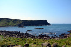 Coast seascape of Ireland with rocks and blue sea in summer Royalty Free Stock Images