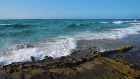 Coast shore wave stone rock foam splash wide. Angle stock video footage