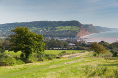 Coast Sidmouth Devon England uk with seats on coastal path Stock Photos