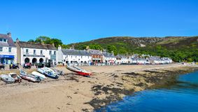 Coast with small houses in the village Ullapool in Scotland stock images