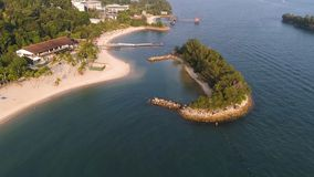 Coast of the small island near the equator line with beautifull forest along the shore and blue water. Shot. Seascape of. Coast of the small island near the stock photos