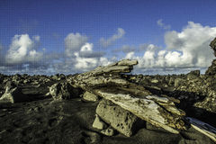 Coast of South Iceland. Rough rocky beaches have claimed many fishing boats and container ships Stock Photos