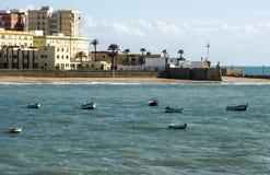 Coast of Cadiz. Coast of the Spanish city of Cadiz on a sunny day. They see boats in the ocean Royalty Free Stock Photos