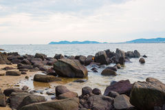 Coast stones. And sea wave over cloudy sky in summer stock photo