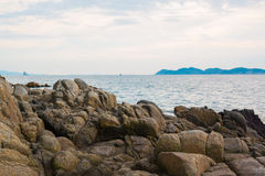 Coast stones. And sea wave over cloudy sky in summer stock photography