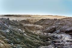 Coast with Stones of volcanic flow Stock Photos