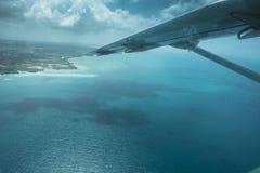 The coast of Tanzania. Airplane wing and coast of Tanzania , view from the small airplane in Africa Royalty Free Stock Photo