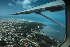 The coast of Tanzania. Airplane wing and coast of Tanzania , view from the small airplane in Africa Stock Images