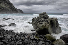 Coast of Tenerife. Coastal area on the NW part of Tenerife island with cliffs and stones washed by waves of Atlantic ocean Royalty Free Stock Photos