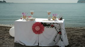 On the coast there is a table with a flower for a romantic date. stock video footage