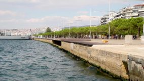 The coast of Thessaloniki city, Greece, clouds over blue sky and residential buildings. Jetty stock footage