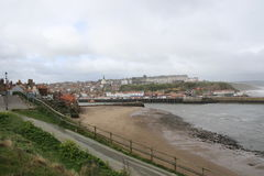Coast tourism Yorkshire. A cloudy and windy day at the historic seaside resort of Whitby Harbour in North Yorkshire Stock Photo