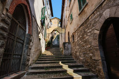 Coast Town Bellano on Como Lake. Narrow streets of authentic Bellano fishing village, situated on Como Lake shore. Traditional italian houses, stone steps and Stock Images