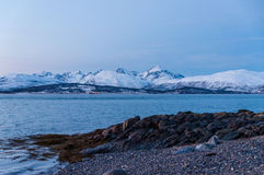 Coast of Tromso city in Tromsoya Island under the Midnight Sun i Stock Photography