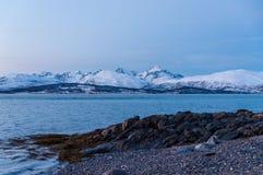 Coast of Tromso city in Tromsoya Island under the Midnight Sun i Stock Photography