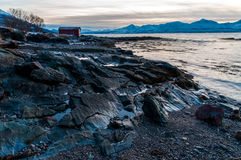Coast of Tromso city in Tromsoya Island under the Midnight Sun i Stock Photo